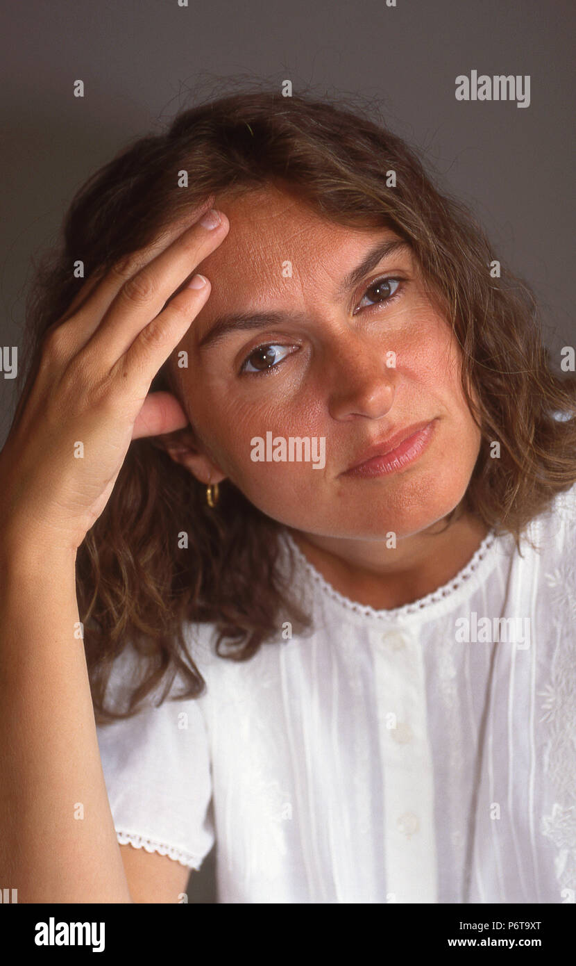 Portrait of women in her mid thirties suffering from stress - Stock Image