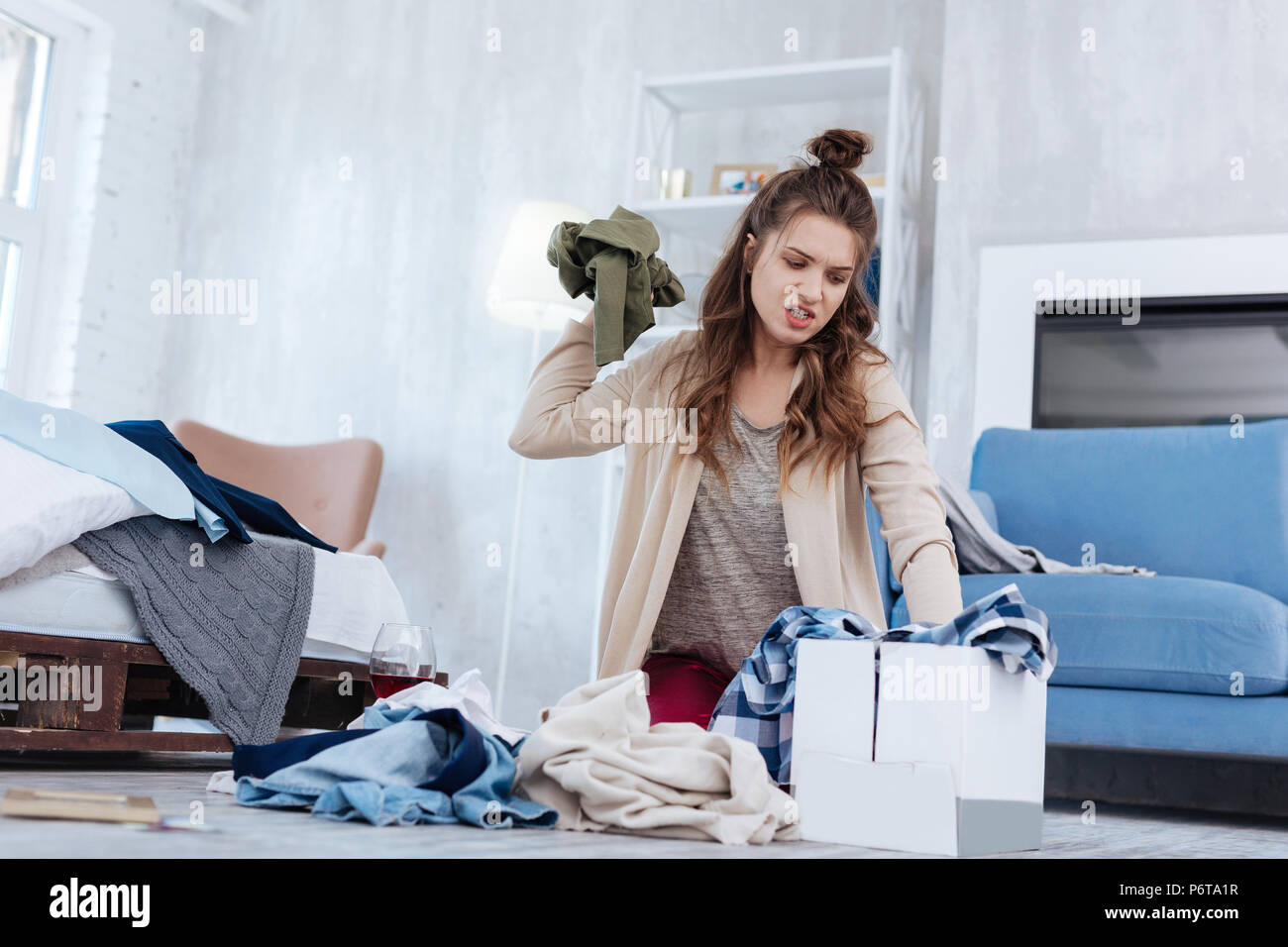 Emotional woman feeling hysterical after divorce - Stock Image