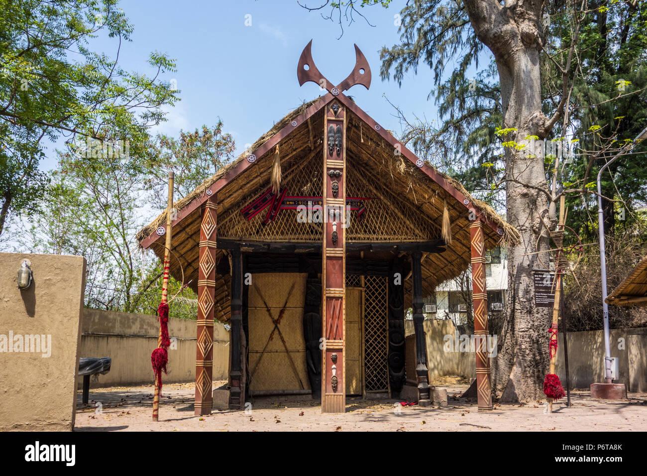 Konyak Morung or traditional Men's House for the men of Konyak Tribe in Nagaland, National Handicrafts and Handlooms Museum, New Delhi, Delhi, India - Stock Image