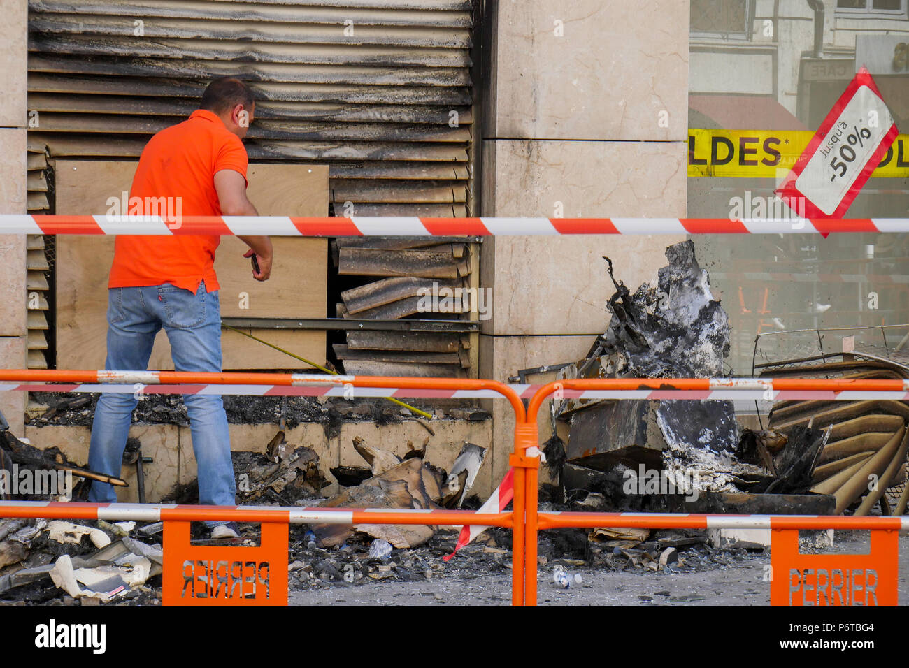 An insurance comapny expert looks at a building damaged by fire, Lyon, France Stock Photo