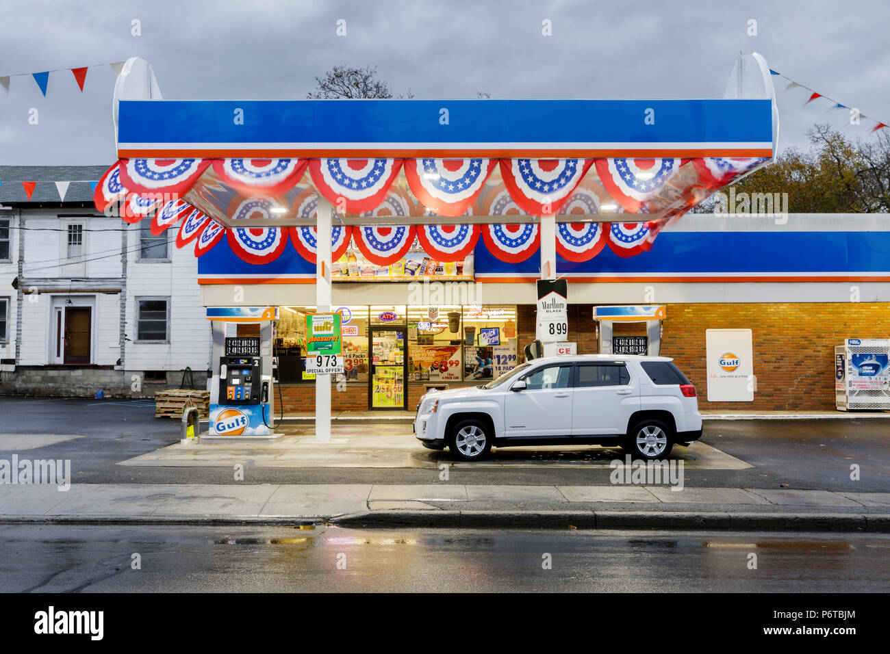 Palatine Bridge, New York, USA: A Gulf gas station at a Cumberland Farms convenience store, spruced up with bunting for a reopening. - Stock Image