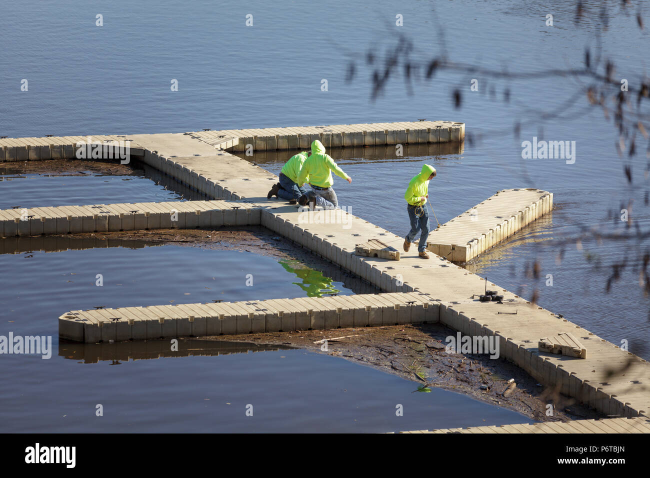 St. Johnsville, New York, USA: At St. Johnsville marina, town employees put the docks away for the winter. - Stock Image