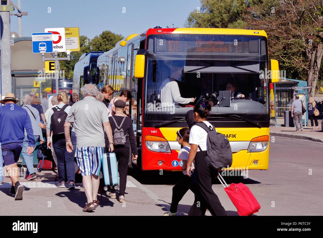 Kalmar, Sweden - June 28, 2018: Passengers at the Kalmar central station enter the public transportation bus with destination Byxelkrok via Borgholm o Stock Photo