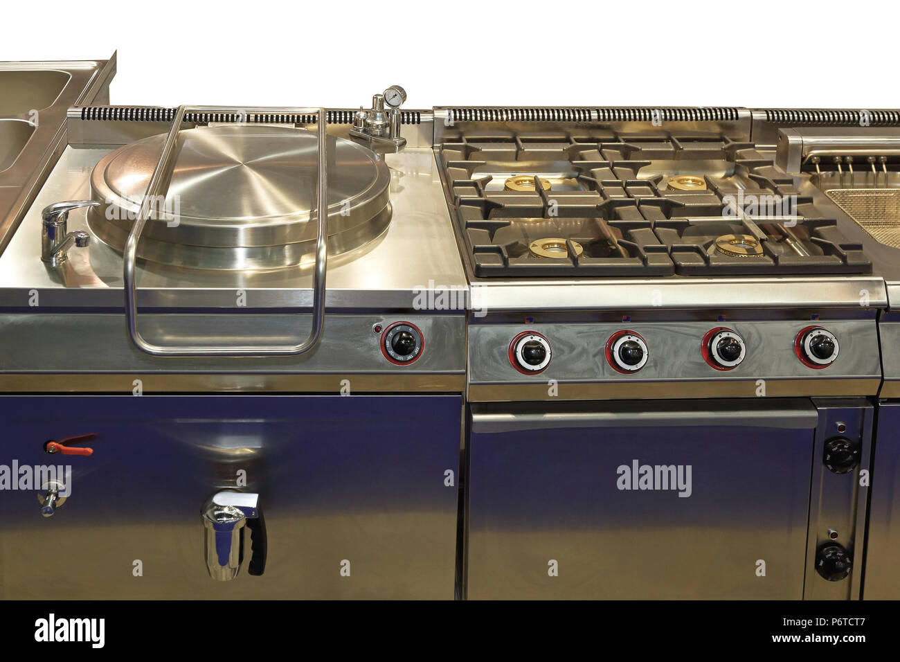 Commercial pressure cooker and big gas range in professional kitchen - Stock Image