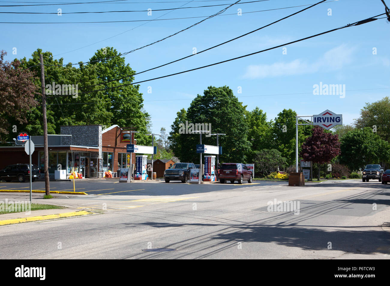June 4, 2018- Middleton, Nova Scotia: The unique looking Irving Gas Station on Main Street, Middleton, Nova Scotia with customers pumping gasa - Stock Image