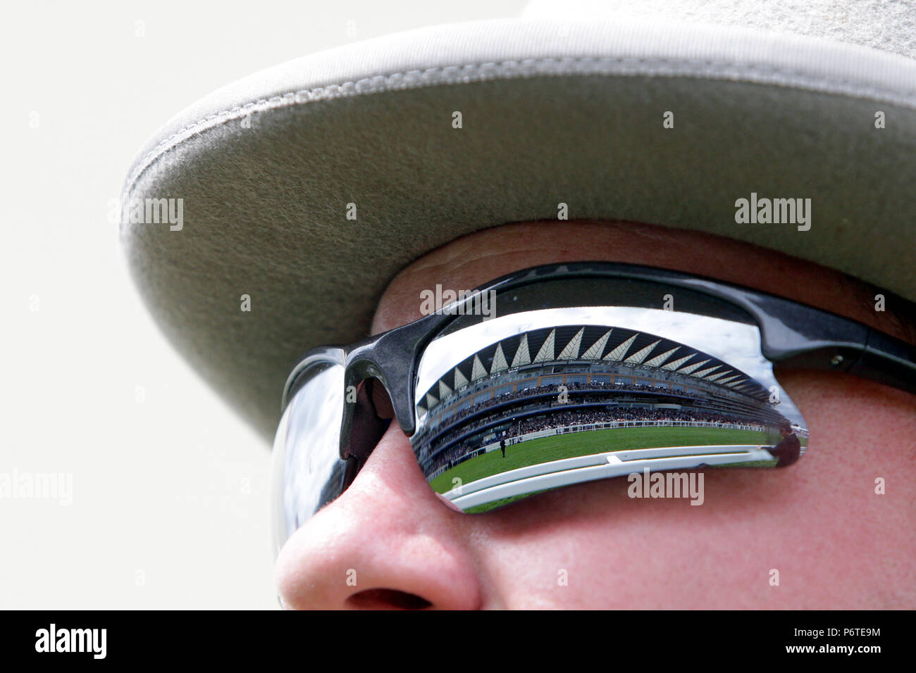 Royal Ascot, the grandstand mirror in the sunglasses of a man - Stock Image