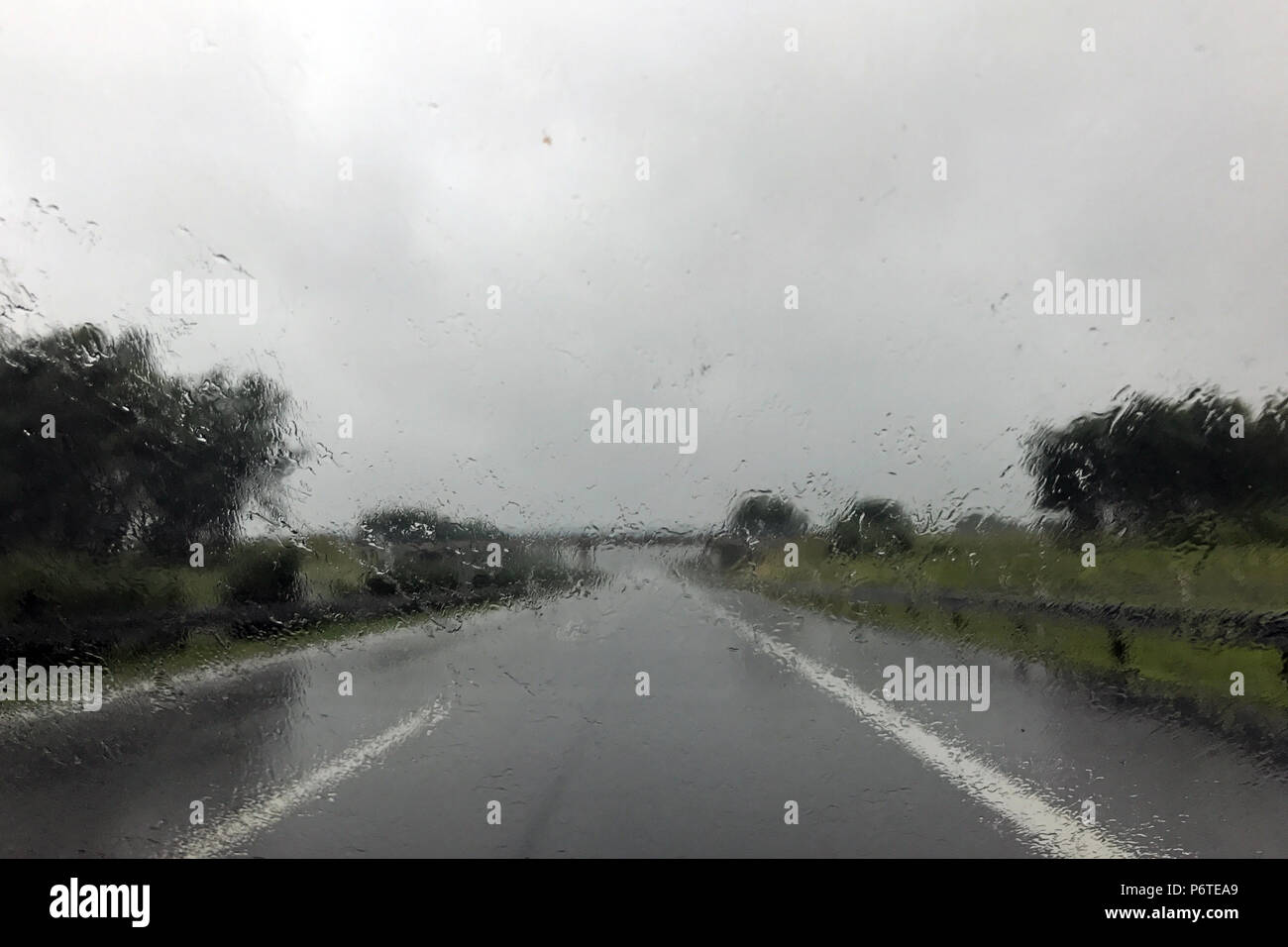 Berlin, Germany, poor visibility during heavy rain on a country road - Stock Image