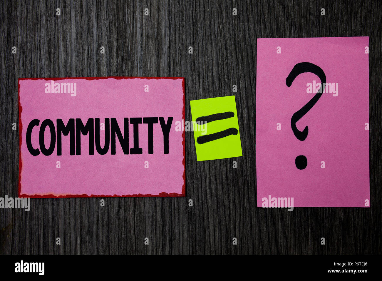 Writing note showing  Community. Business photo showcasing Neighborhood Association State Affiliation Alliance Unity Group Pink notes equal sign quest - Stock Image