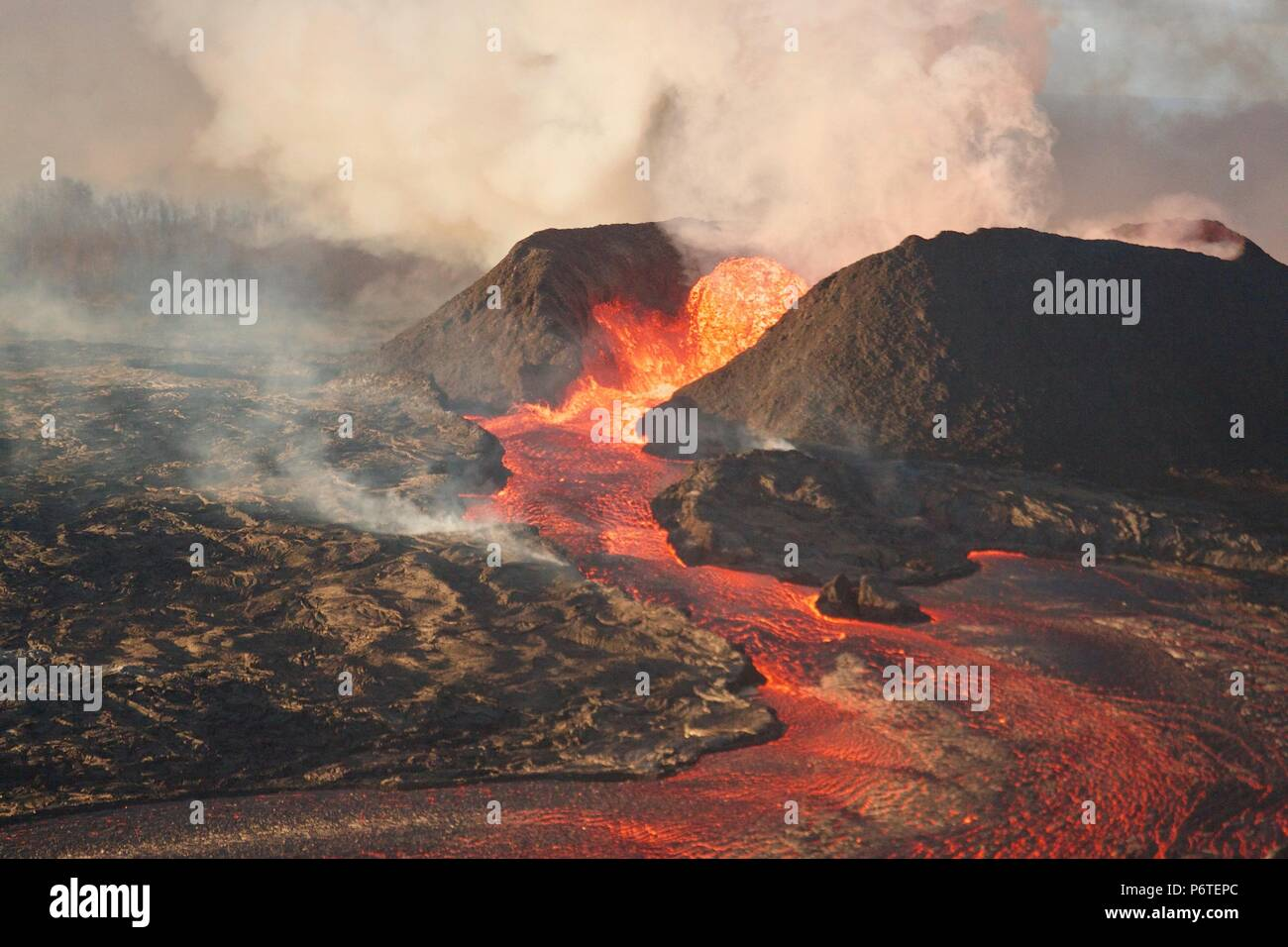 A massive lava fountain spewing magma 180 feet into the air from fissure 8 at the corner of Nohea and Leilani caused by the eruption of the Kilauea volcano June 30, 2018 in Hawaii. The recent eruption continues destroying homes, forcing evacuations and spewing lava and poison gas on the Big Island of Hawaii. - Stock Image