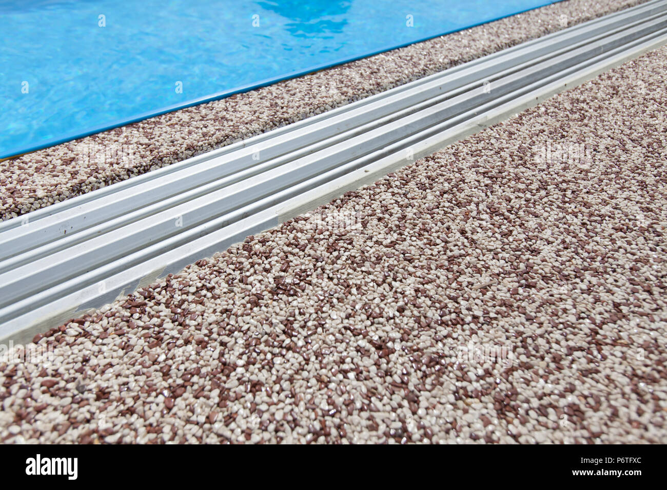 Texture Of Pebbles In An Exposed Aggregate Foundation   Stock Image
