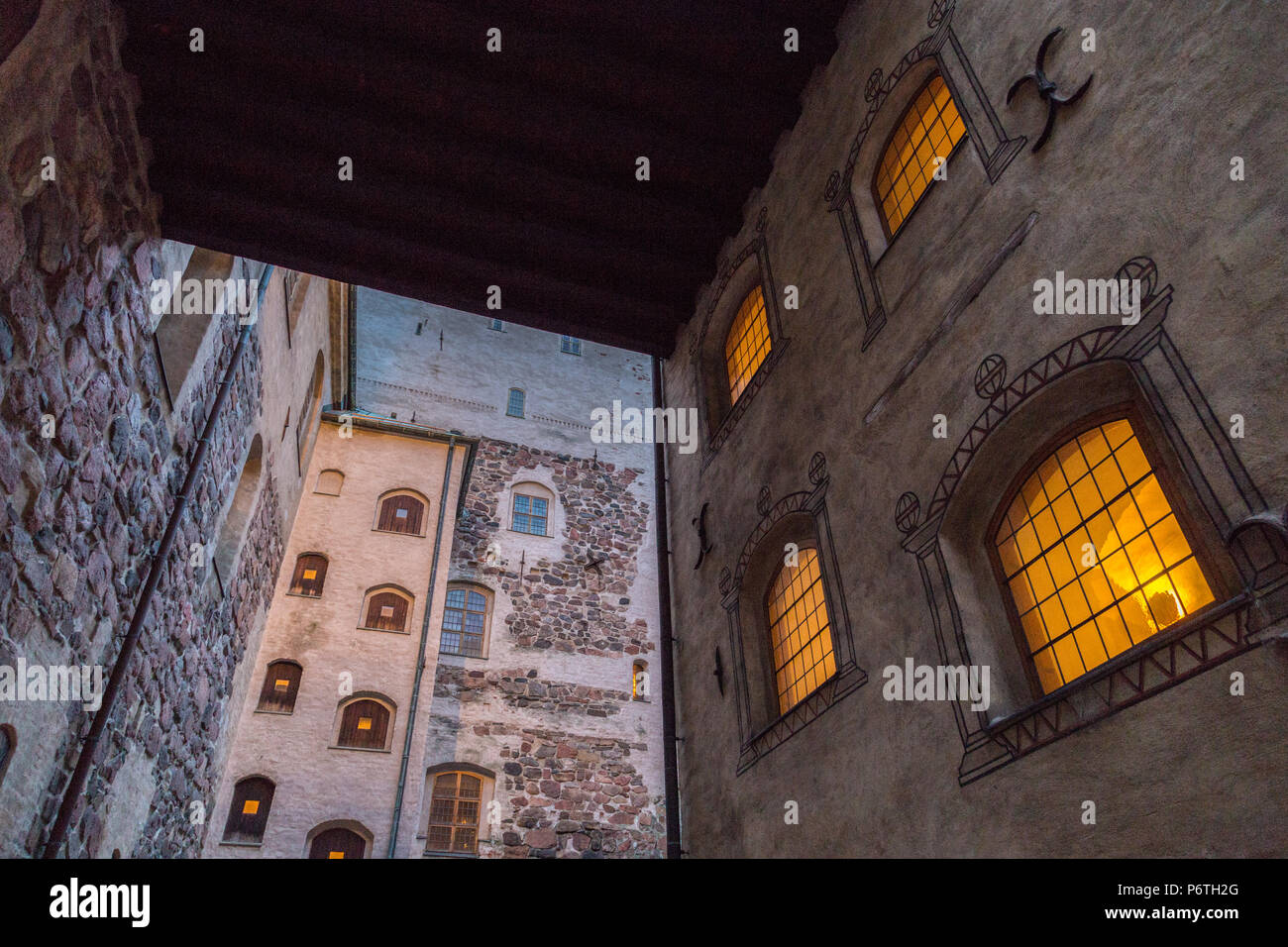 Walls and windows of courtyard of Turku Caste evening dusk - Stock Image