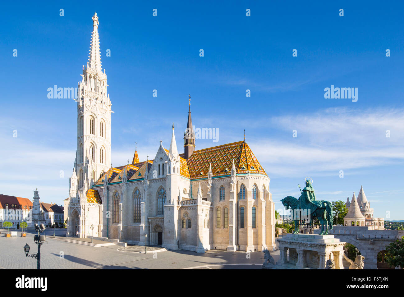 Hungary, Central Hungary, Budapest. St. Matthias Church and St Stephen Statue are located adjacent to Fisherman's Bastion, which takes it's name from the guild of fishermen responsible for defending this stretch of the city during the Middle Ages. - Stock Image