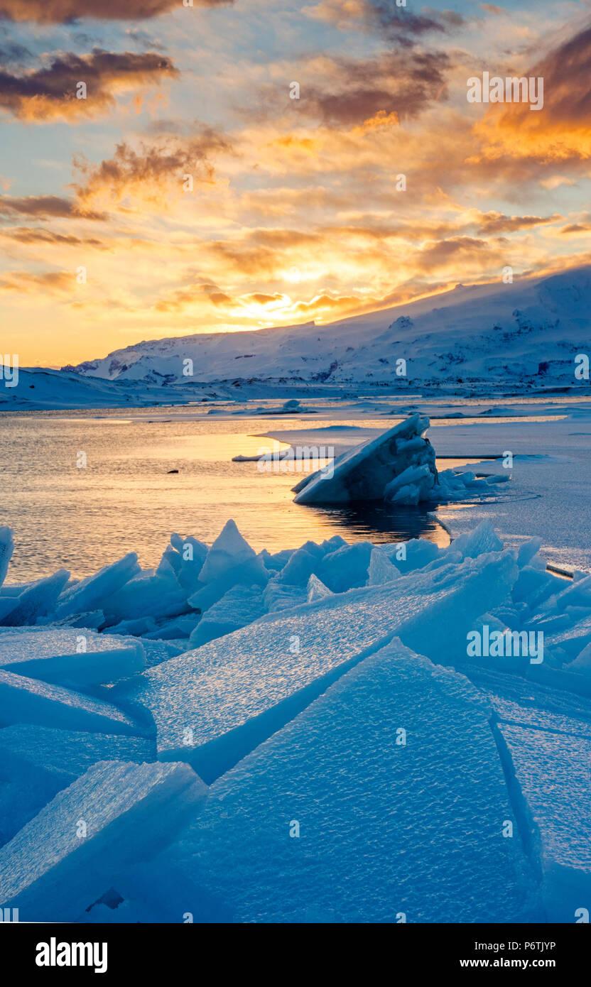 Jokulsarlon glacier lagoon, Iceland, Europe. Blocks of ice in the frozen lagoon on a winter sunset. - Stock Image
