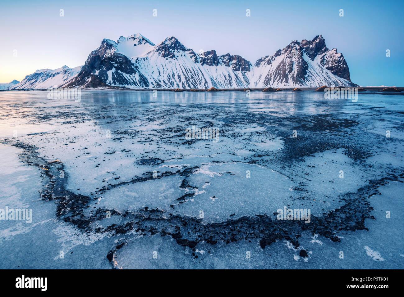Stokksnes, Eastern Iceland, Europe. Vestrahorn mountain in a frozen winter landscape. - Stock Image
