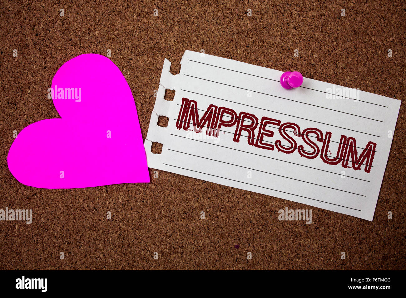Handwriting text Impressum. Concept meaning Impressed Engraved Imprint German statement ownership authorship Piece notebook paper grunge ideas pink he - Stock Image