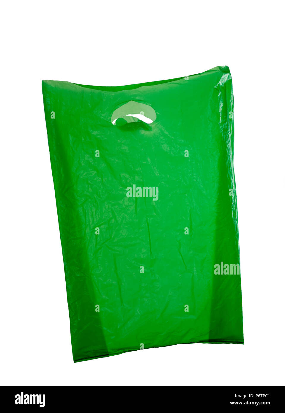 Used and reused green plastic bag isolated on white background - Stock Image