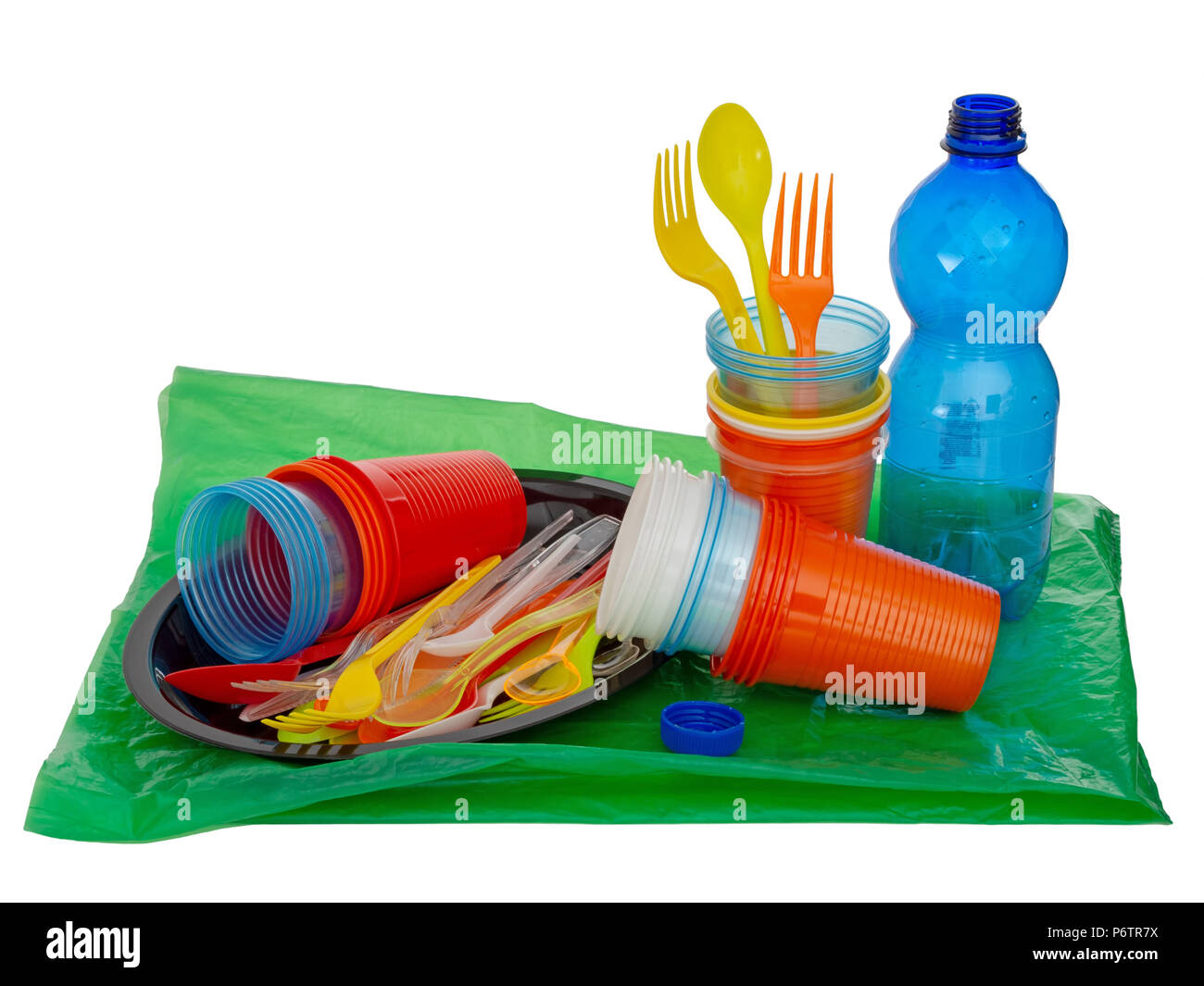 Single use, disposable plastic including cutlery, evironmental problem, EU directive. Isolated on white. - Stock Image