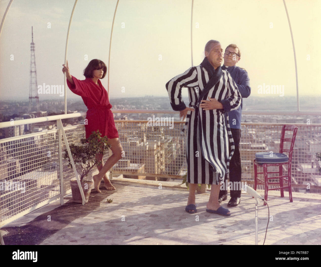 Italian actor Alberto Sordi and Tina Aumont in the movie Scusi Lei è Favorevole o Contrario?, 1967 - Stock Image