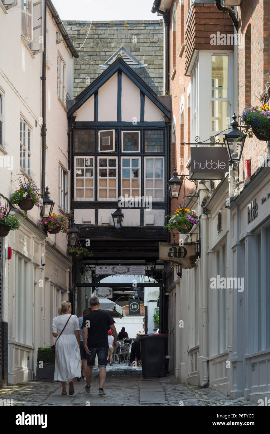 The Angel Hotel courtyard and narrow cobbled street off the high street in Guildford town centre, Surrey, UK - Stock Image