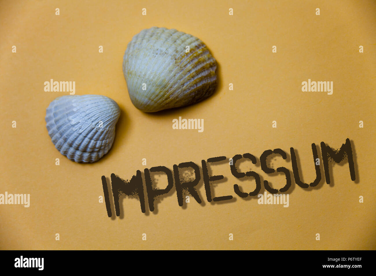 Handwriting text writing Impressum. Concept meaning Impressed Engraved Imprint German statement ownership authorship Grunge ideas messages shells ligh - Stock Image