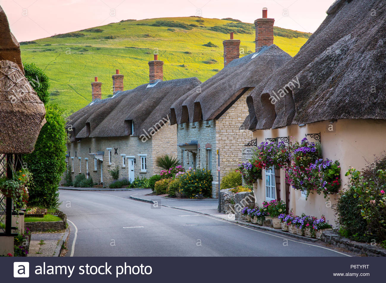 Thatched roof cottages in West Lulworth, Dorset, England - Stock Image