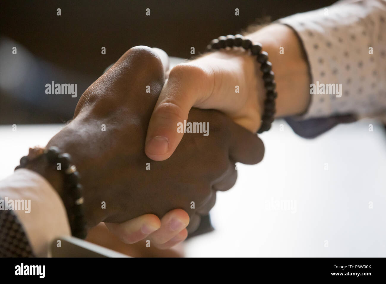 Multiracial people handshaking greeting with achievement or succ - Stock Image