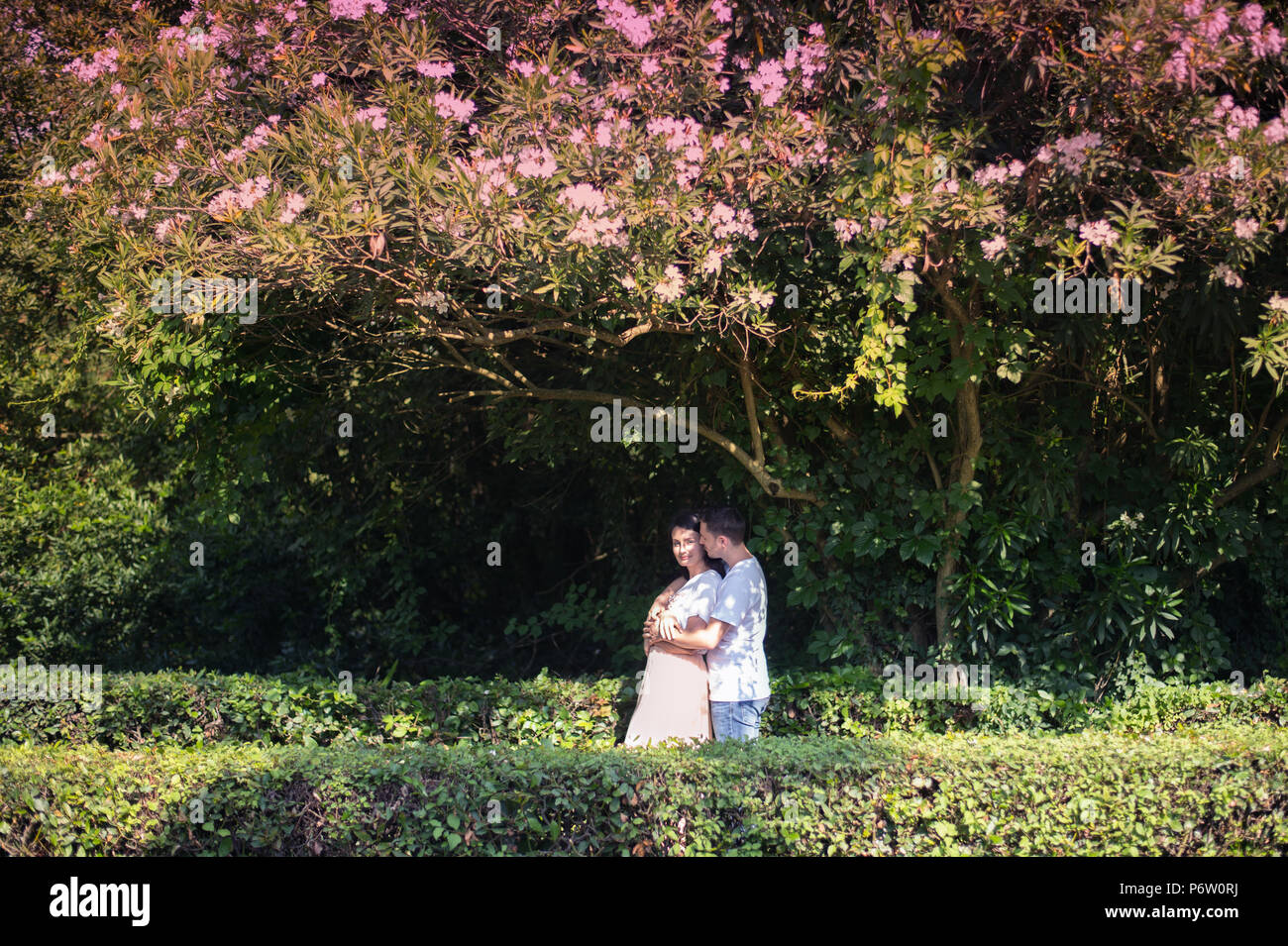 Couple in love - Beginning of a Love Story. A man and a girl romantic date in a park - Stock Image