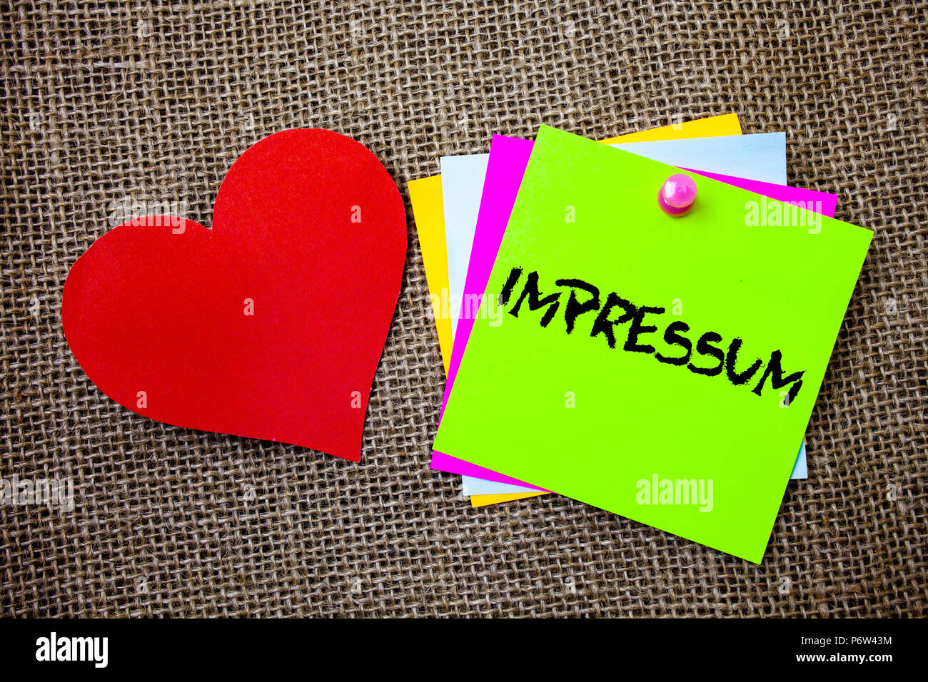 Text sign showing Impressum. Conceptual photo Impressed Engraved Imprint German statement ownership authorship Ideas things to do messages intentions  - Stock Image
