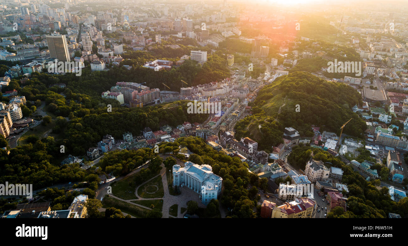 Aerial Panoramic view to the Andreevsky Descent at sunset with the St. Andrew's Church and emerald hills Stock Photo