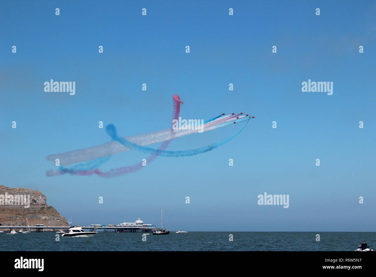 Armed Forces Day. Llandudno. The Red Arrows performing aerobatic - Stock Image