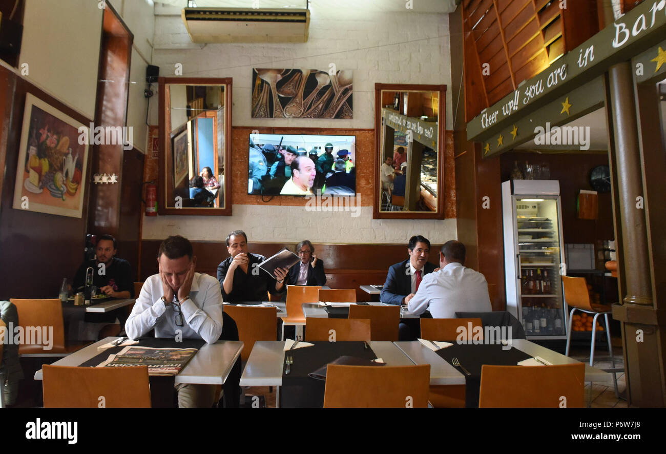 October 2 2017 Barcelona Spain People Eat In A Restaurant In Barcelona As The Large Tv