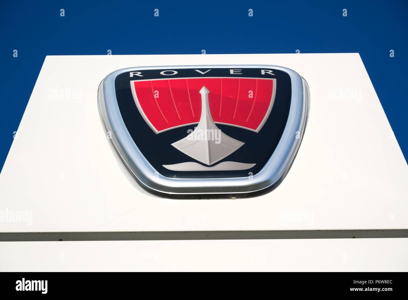 Rover dealership sign against blue sky. - Stock Image