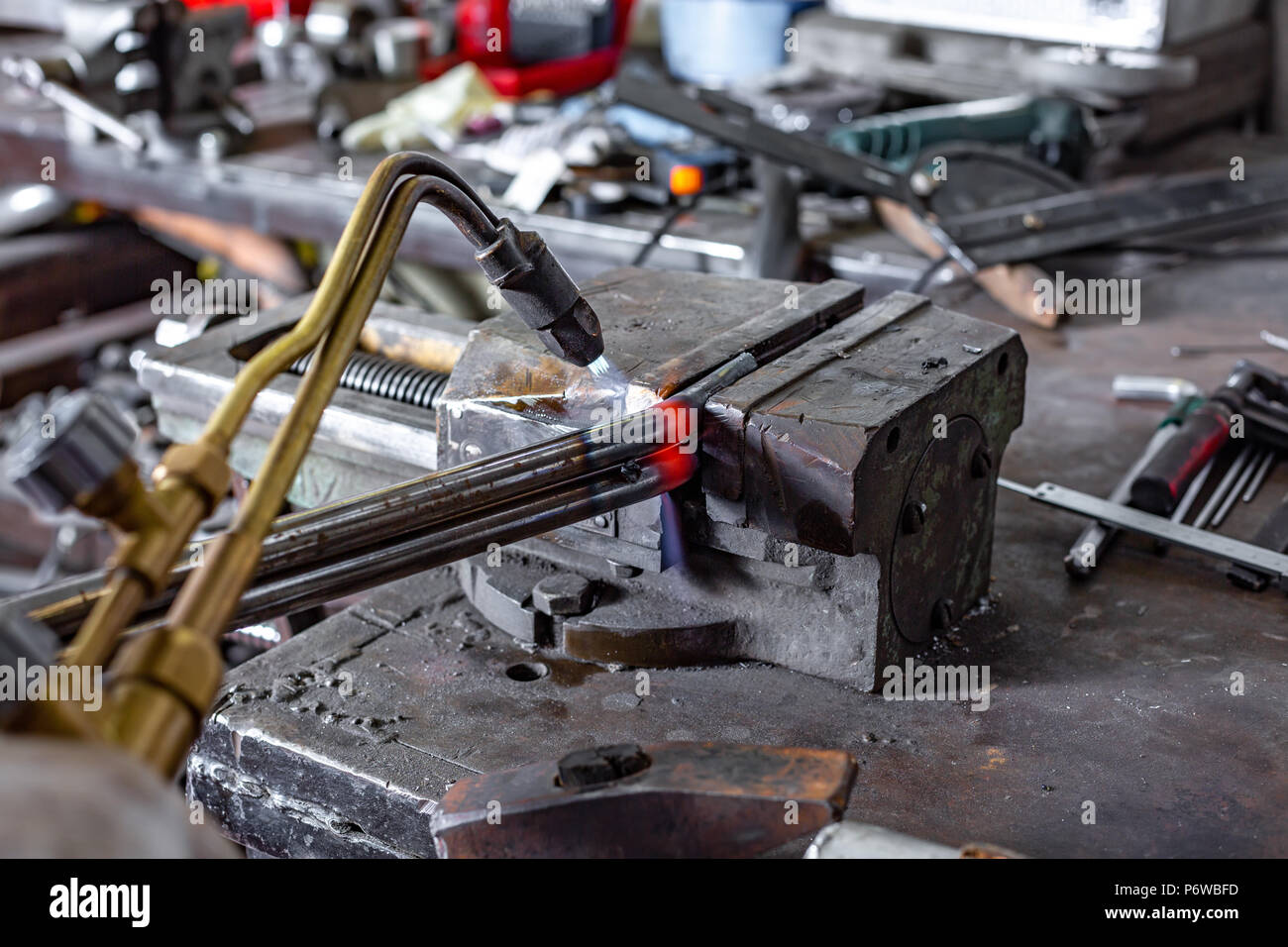autogenous is going to cut a piece of metal welding. Stock Photo