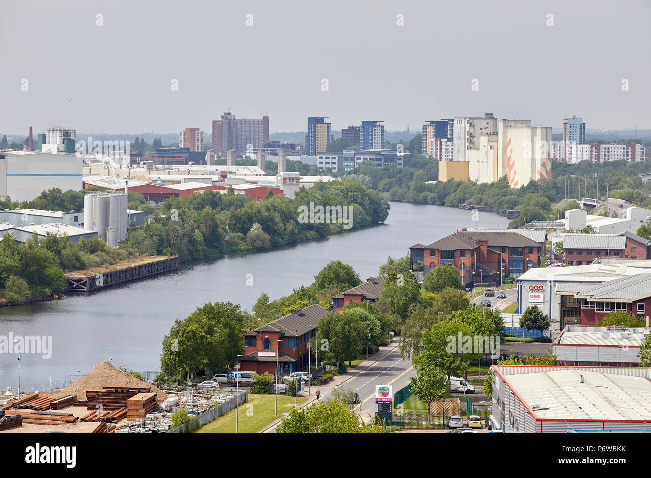 industry along the banks of Manchester Ship canal looking out over Salford and Trafford Park - Stock Image
