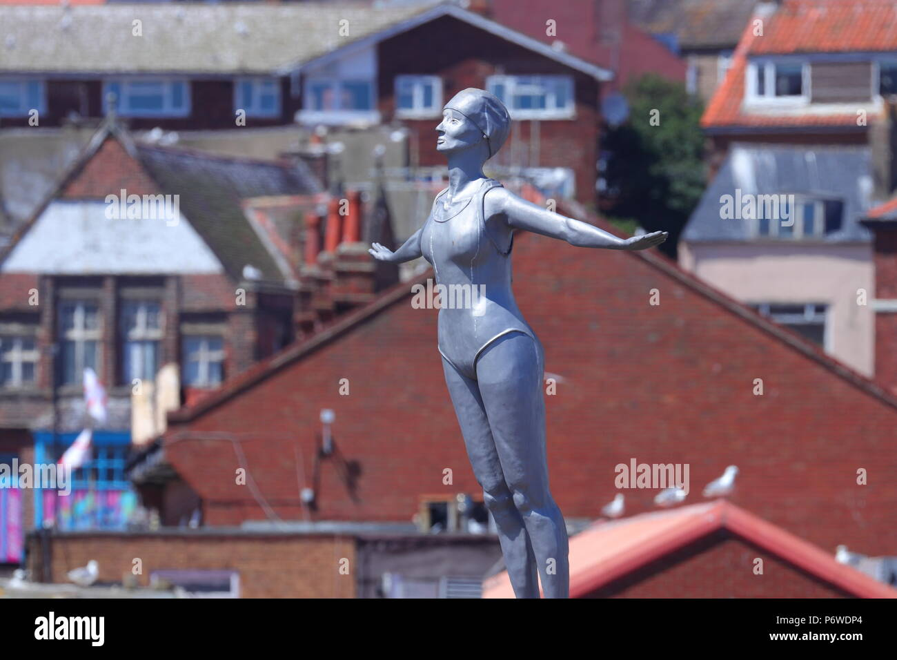 The Diving Belle Sculpture located outside the lighthouse in Scarborough. - Stock Image