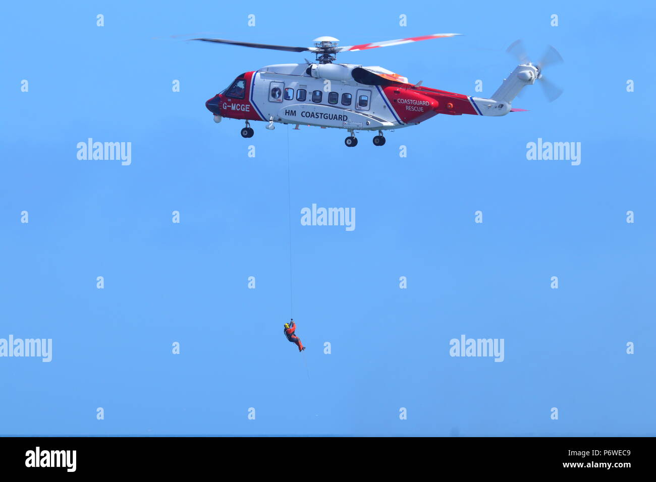 A Sikorsky S-92 putting on a public training exercise with Scarborough RNLI during National Armed Forces Day Stock Photo