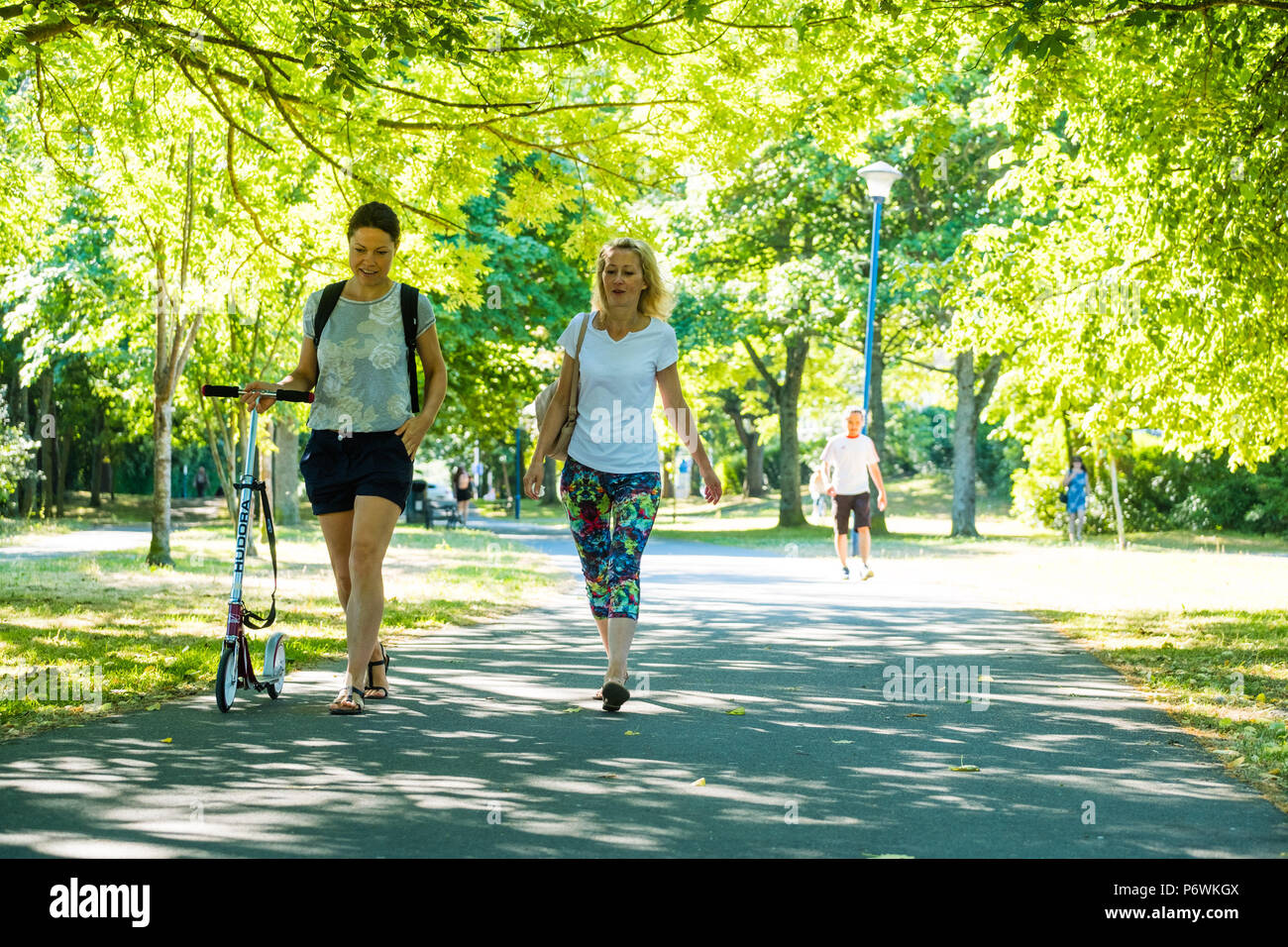 Aberystwyth, Wales, UK. 3rd July, 2018. UK Weather: People walking Plas Crug park on another hot and sunny Morning in Aberystwyth Wales. The prolonged period of extreme heat and very dry weather is forecast to last for another two weeks, bringing the threat of drought and water shortages to some areas. photo Credit: keith morris/Alamy Live News - Stock Image