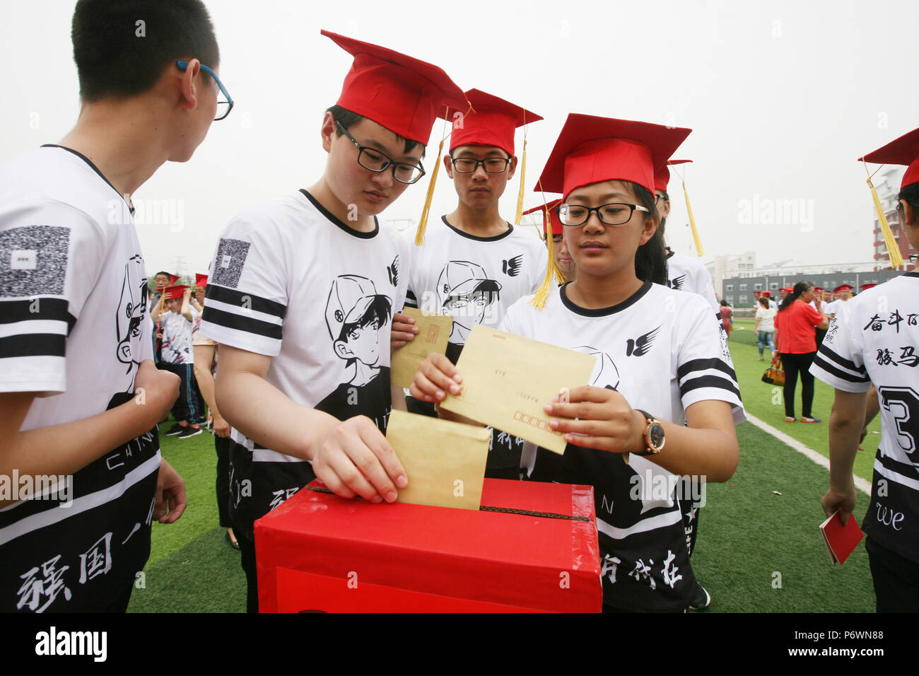 Changzhi, China's Shanxi Province. 3rd July, 2018. Students cast letters written by themselves to the future into a box at their coming-of-age ceremony held at Wuxiang high school in Wuxiang County, north China's Shanxi Province, July 3, 2018. Credit: Li Yong/Xinhua/Alamy Live News - Stock Image