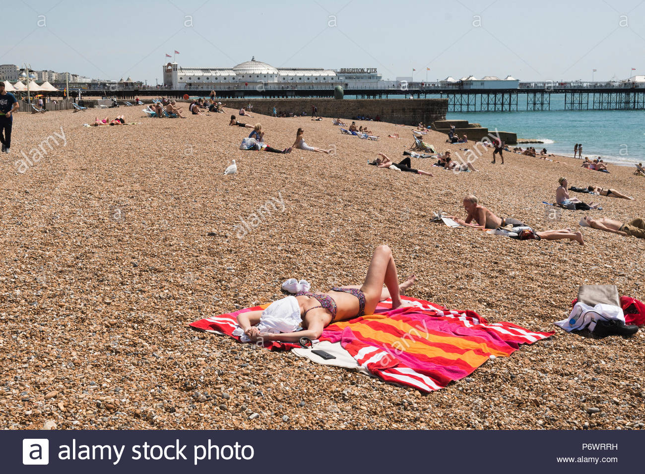 Brighton Beach, Sussex, UK. 3rd July 2018. UK heatwave continues as people still flock to the coast to soak up the hot weather while it lasts as temperatures still register into the late twenties degree centigrade. - Stock Image
