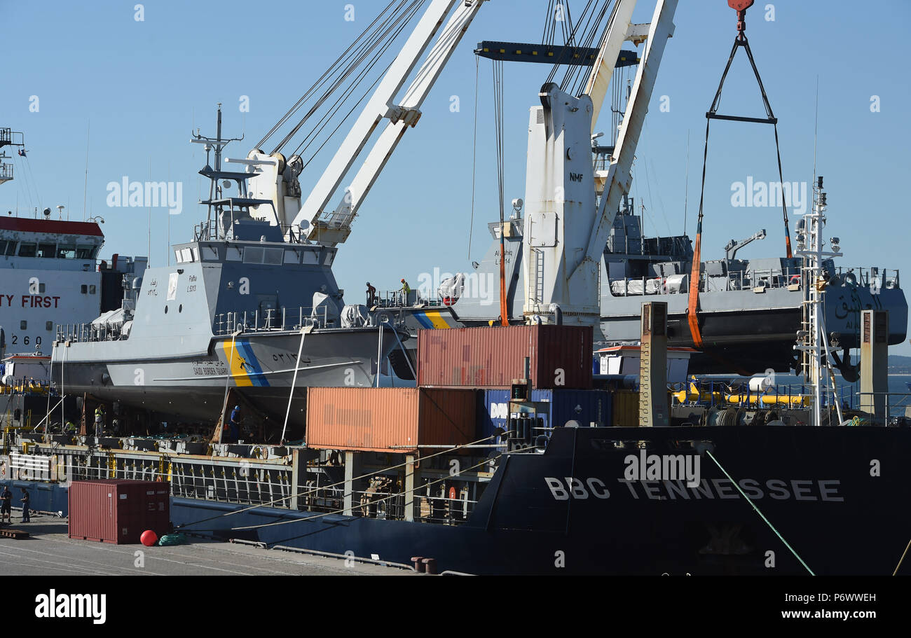 Sassnitz, Germany. 03rd July, 2018. A coast guard boat for Saudi Arabia being loaded on a transport ship in the port of Mukran. The Luerssen Group from Bremen, owner of the Wolgaster Shipyards, received an order valued in the billions of euros for the construction of a fleet of new patrol boats for Saudi Arabia and began with construction works in 2015. Only in March this year, however, did the federal government approved the delivery to the Kingdom of 8 further ships. Around 300 workers are employed by the Wolgaster Luerssen Shipyards. Credit: Stefan Sauer/dpa-Zentralbild/dpa/Alamy Live NewsStock Photo