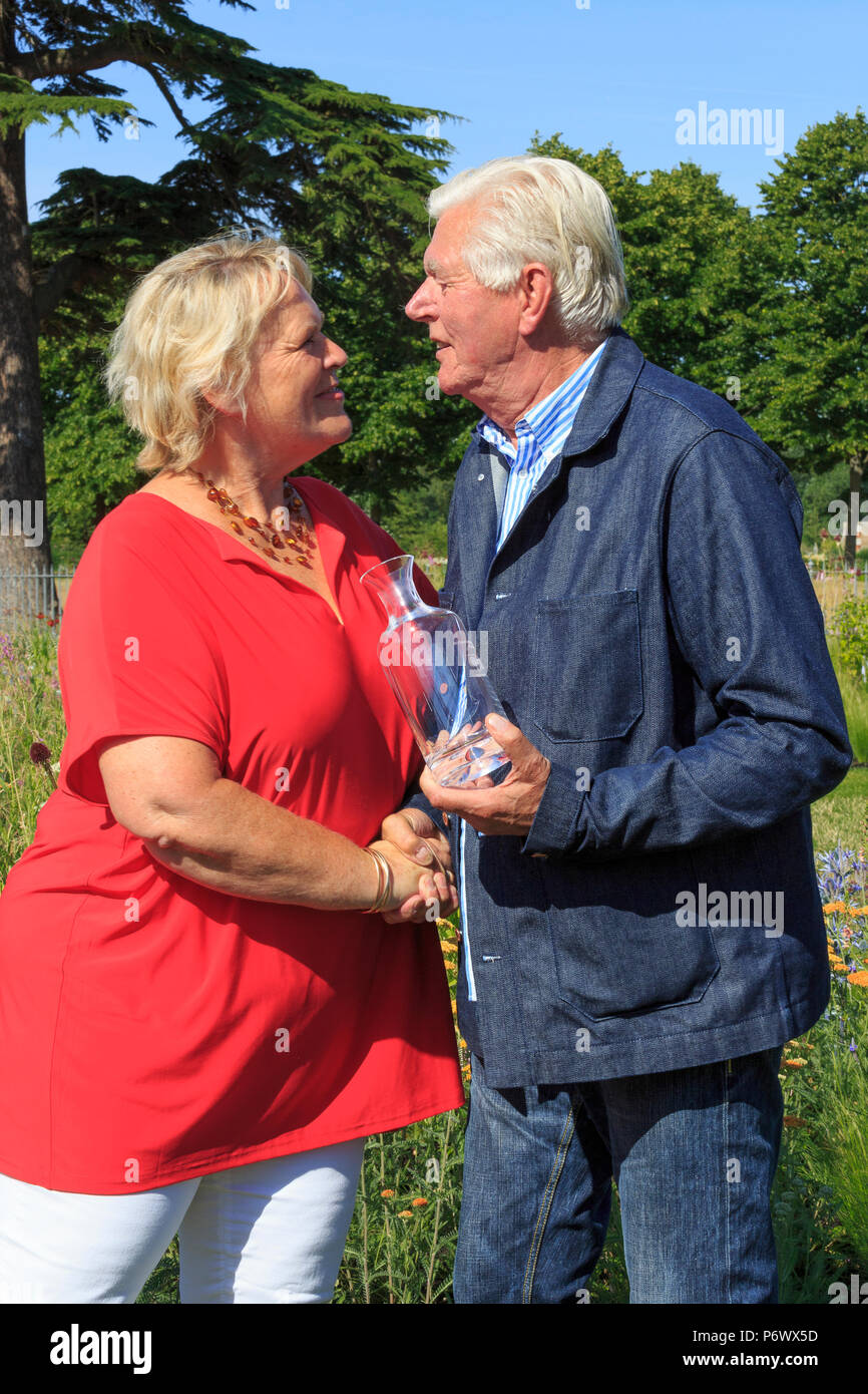 London, UK. 2nd-8th July 2018. RHS Hampton Court Flower Show. Iconic Horticultural Heroes.  Dutch landscape designer, plantsman and author Piet Oudolf receiving an award from RHS Director General Sue Biggs at Hampton Court Flower Show to celebrate Piet's iconic achievement in garden design. - Stock Image