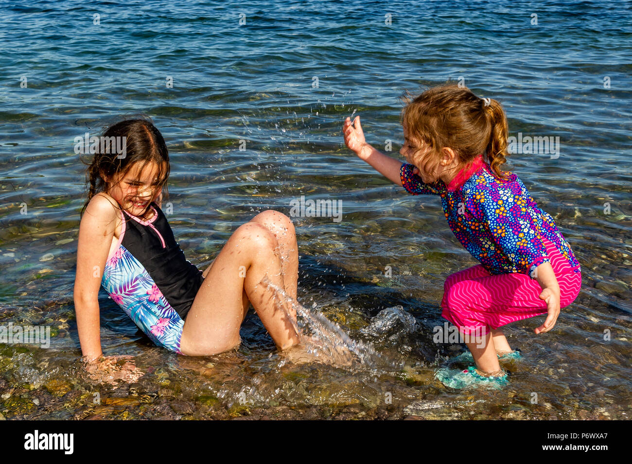 Schull, West Cork, Ireland. 3rd July, 2018. Laura and Sophia Maguire from Dublin cool off in the sea on another blisteringly hot day. The heatwave shows no sign of ending with temperatures forecast to be in the high 20°'s Celsius for at least a week. Credit: Andy Gibson/Alamy Live News. - Stock Image