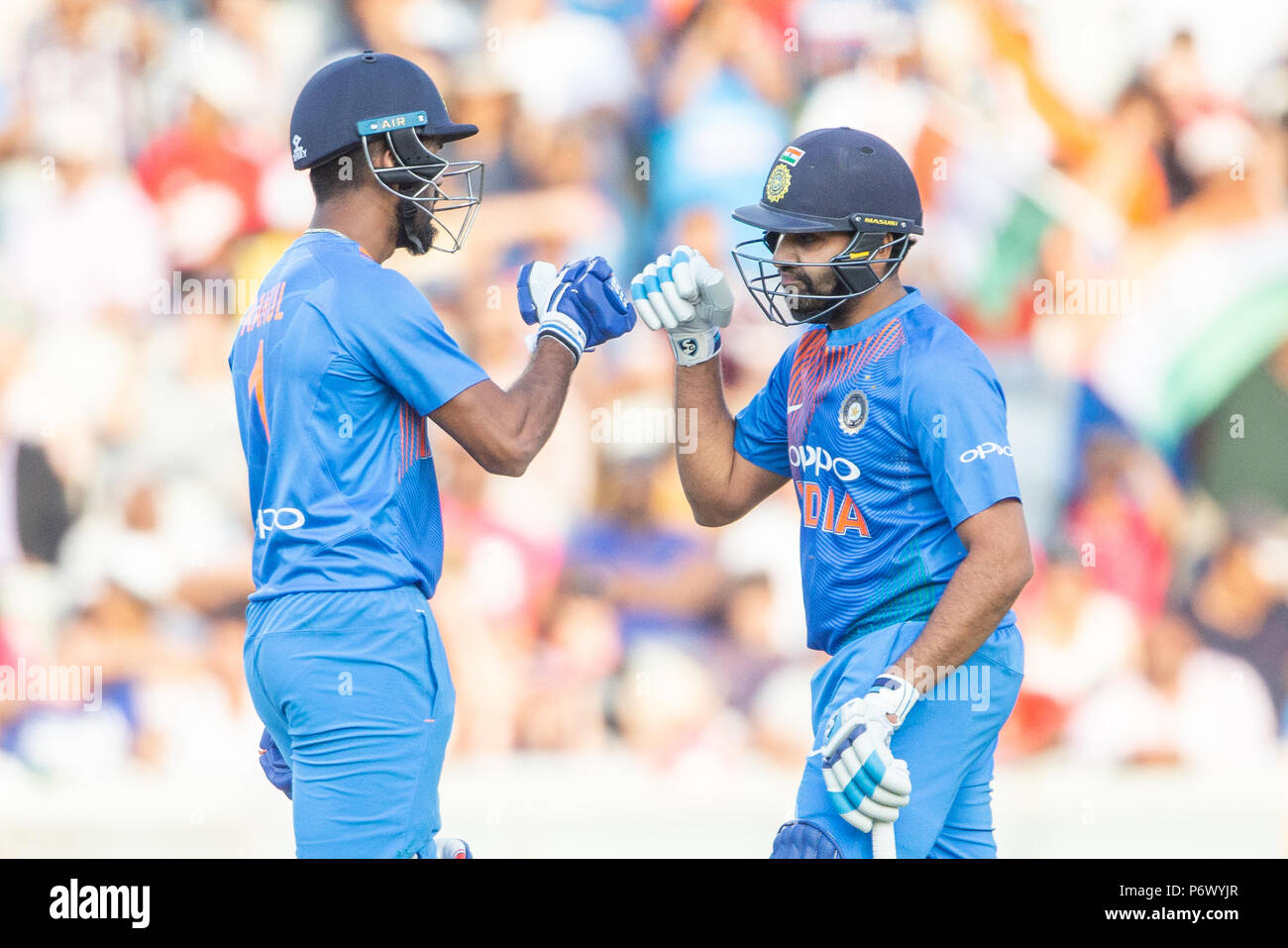 Manchester, UK. 3rd of July 2018 , Emirates Old Trafford, Manchester, England, 1st IT20, Vitality IT20 Series, England v India; Rohit Sharma of India and KL Rahul of India punch gloves as they are hitting England for six Credit: News Images /Alamy Live News - Stock Image