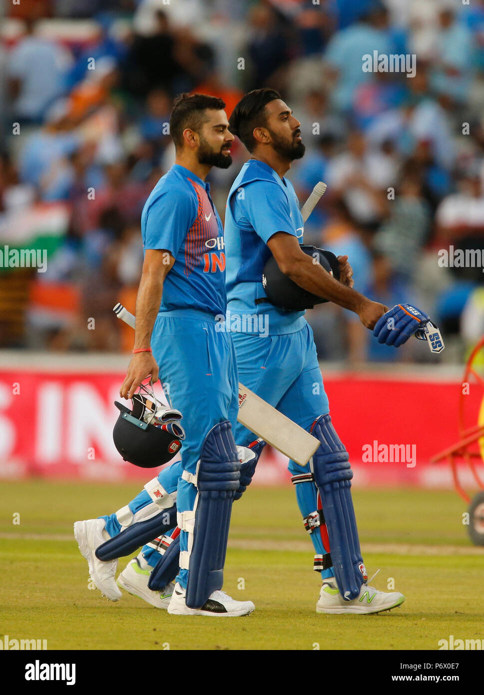 Emirates Old Trafford, Manchester, UK. 3rd July, 2018. International Twenty20 cricket, England versus India; Virat Kohli and KL Rahul of India walk off the field having guided India to victory by eight wickets Credit: Action Plus Sports/Alamy Live News - Stock Image