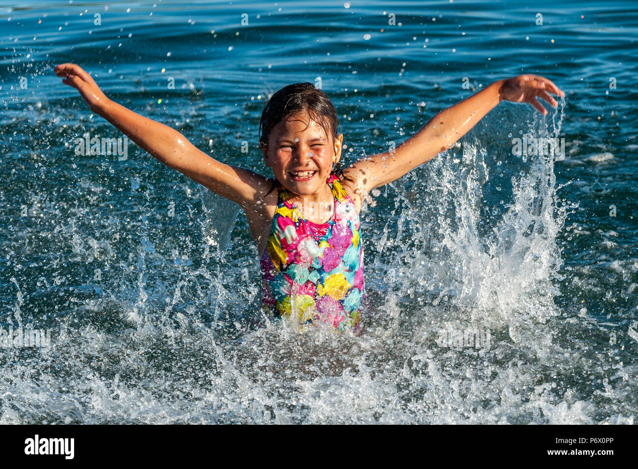 Schull, West Cork, Ireland . Hannah O'Driscoll, 7, from Ballydehob, plays, in the sea this evening. The heatwave shows no sign of ending with temperatures forecast to be in the high 20°'s Celsius for at least a week. Credit: Andy Gibson/Alamy Live News. - Stock Image