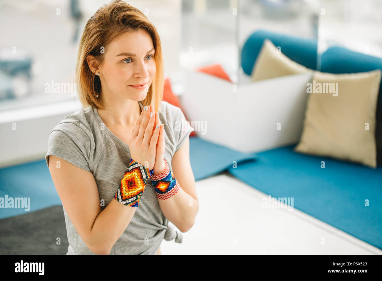 Portrait Of Blonde Yogi Teacher Thanking Or Greeting Her Pupils With