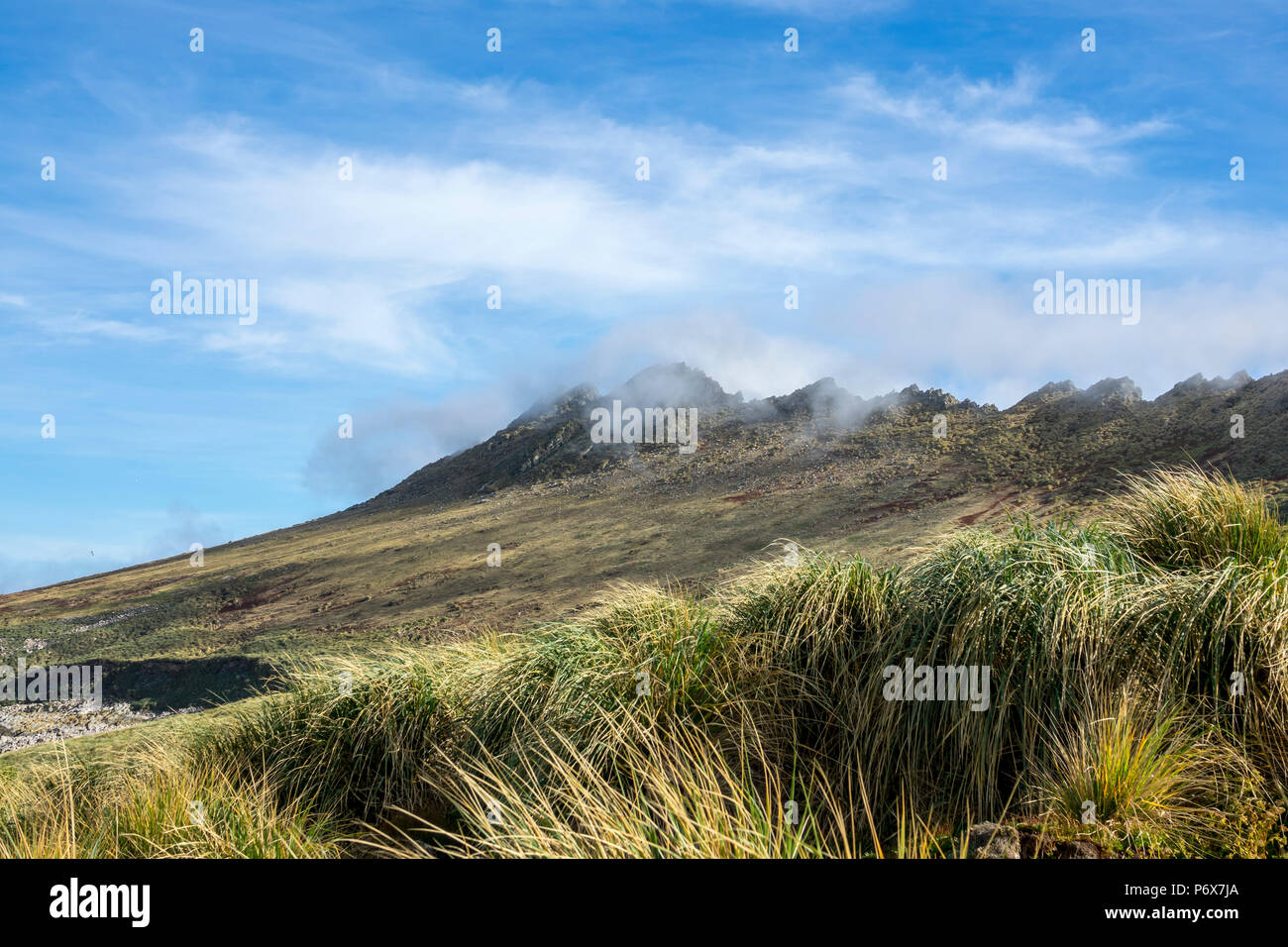 Clouds rolling over the peaks of Steeple Jason Island, Falkland Islands Stock Photo
