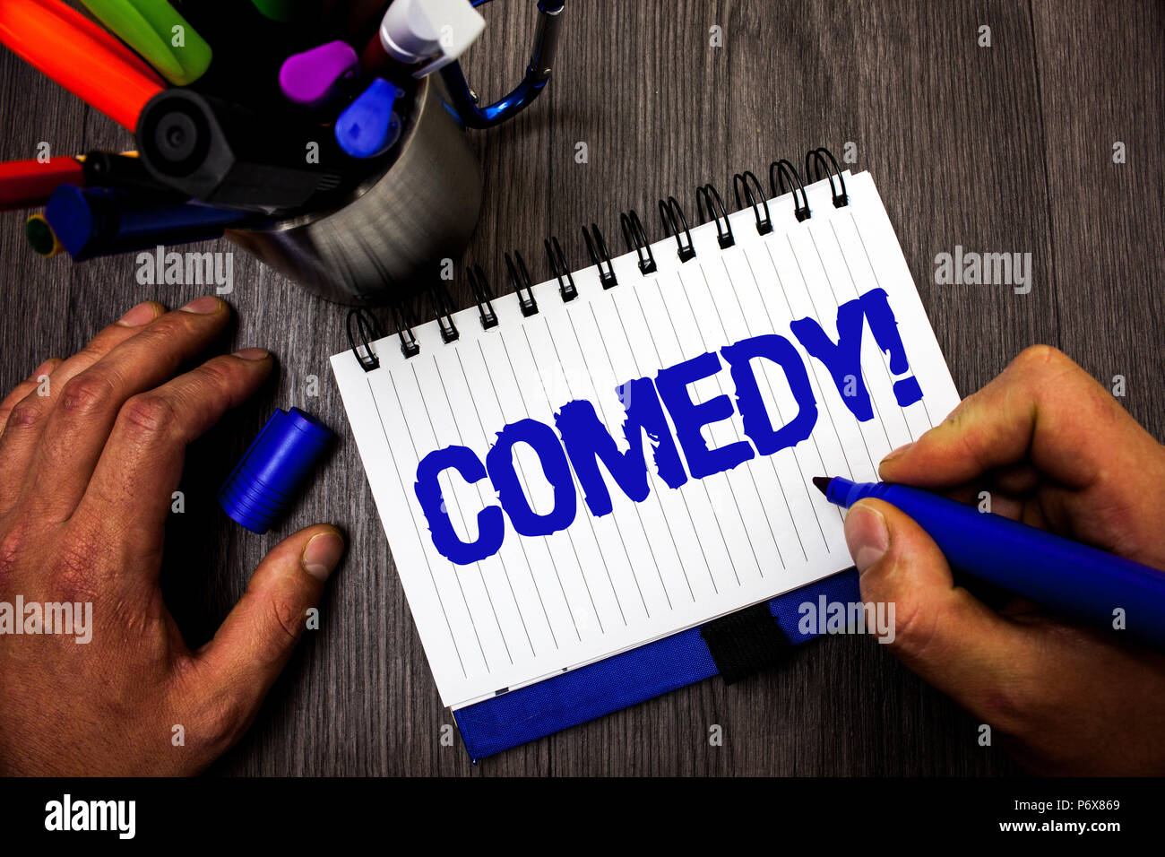 Handwriting text writing Comedy Call. Concept meaning Fun Humor Satire Sitcom Hilarity Joking Entertainment Laughing Man hold holding marker notebook  - Stock Image