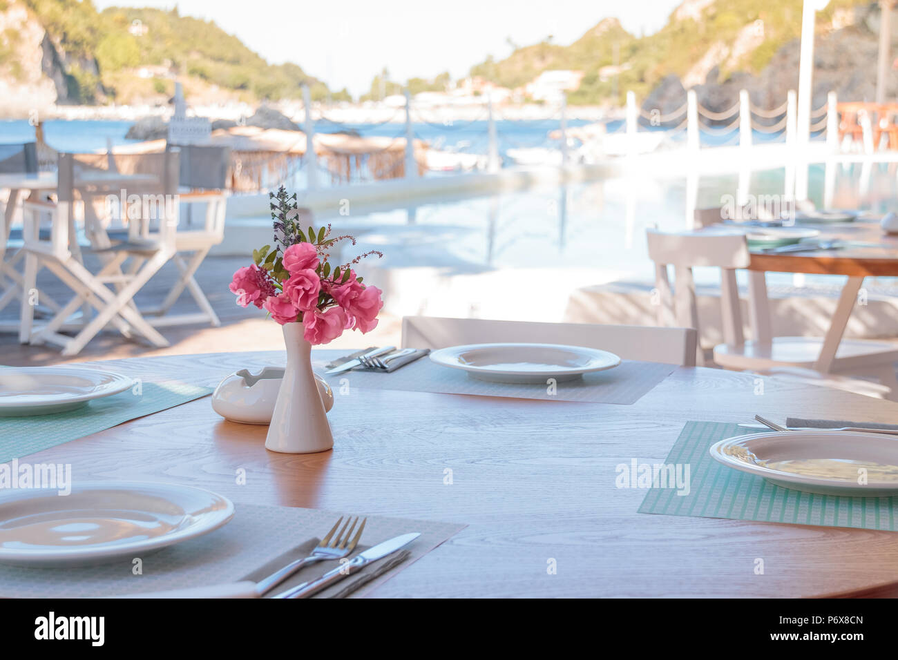 Summer Terrace Of The Restaurant On The Tables Laying With White Plates Of Wine Glasses And