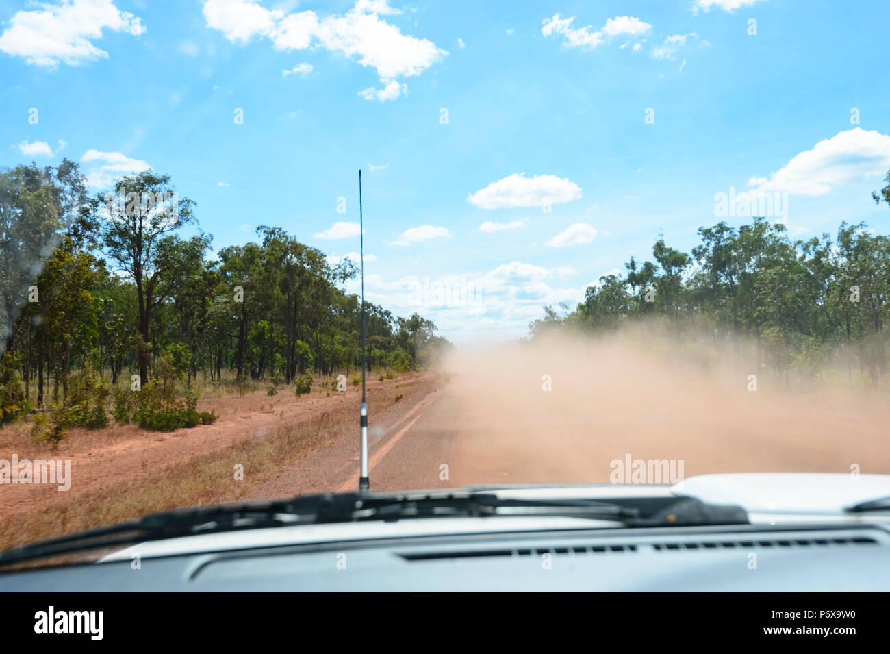 Hazardous driving through flying red dust on the Peninsula Development Road (PDR), Cape York Peninsula, Far North Queensland, FNQ, QLD, Australia - Stock Image